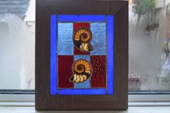 stained glass panel with ammonites
